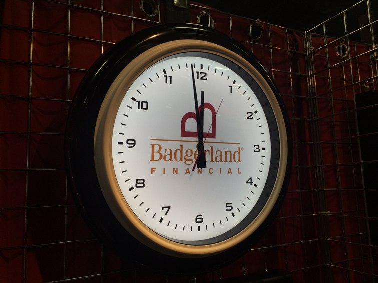 "Backlit illuminated wall clock. These 22"" lighted clocks have a minimum order of 10 pieces."