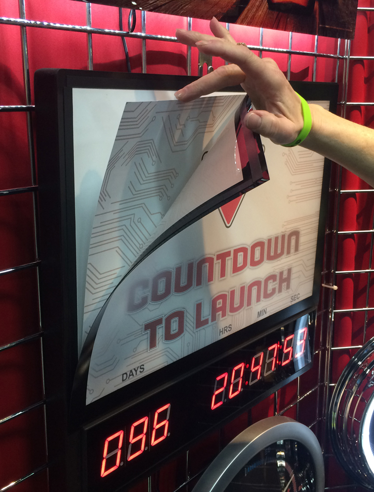 LED Countdown clock with interchangeable top advertising panels.